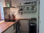 Woodpecker Annexe: the kitchen, showing the ceramic hob.